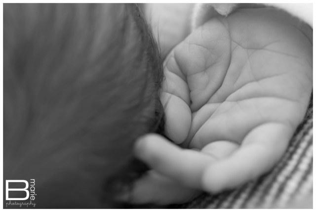 Nacogdoches photographer newborn portraits black and white close up of sleeping baby's hand by his head
