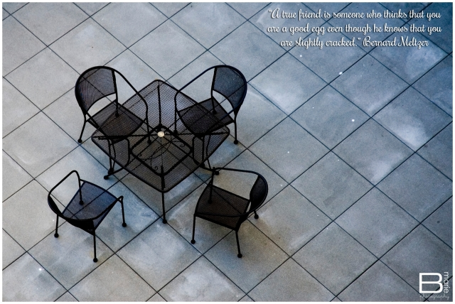 Nacogdoches photographer image of empty table and chairs on geometric patio with a Bernard Meltzer quote about friendship