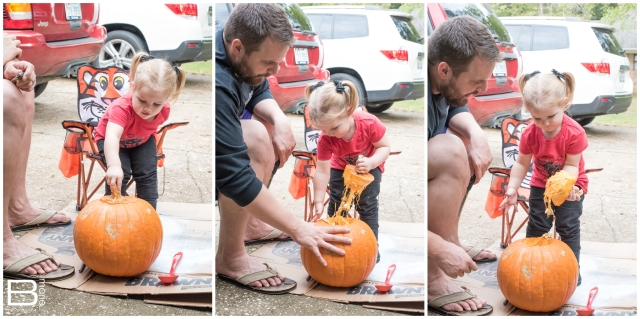 Nacogdoches photographer little girl and her daddy carve her first pumpkin