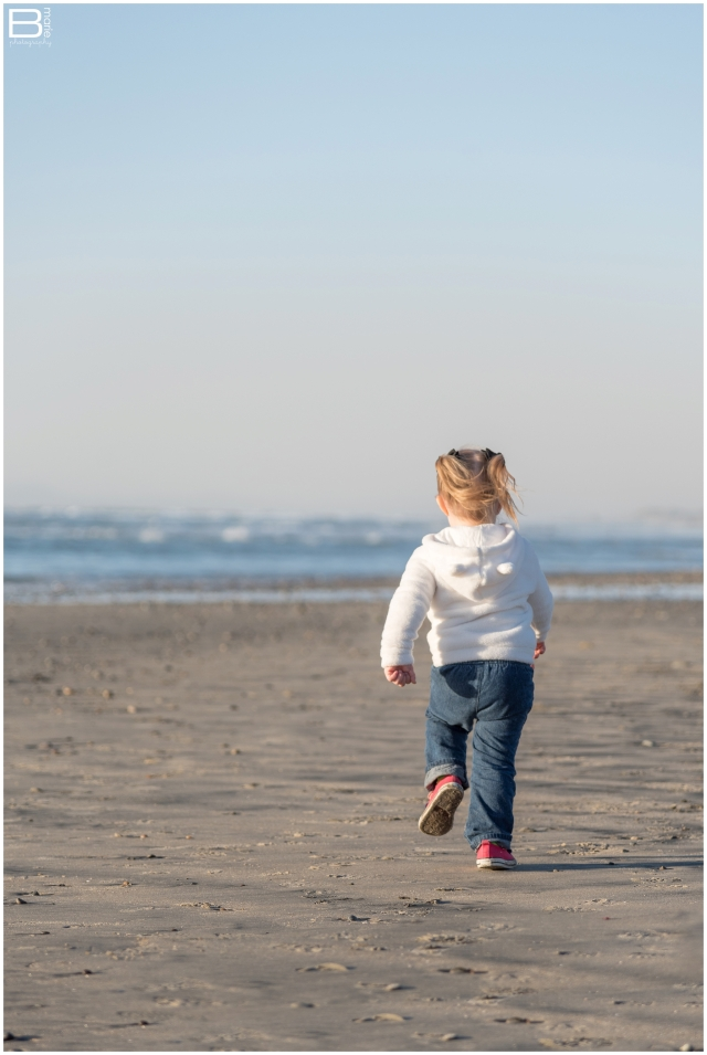 Nacogdoches photographer image of toddler girl running on the beach in San Diego, CA