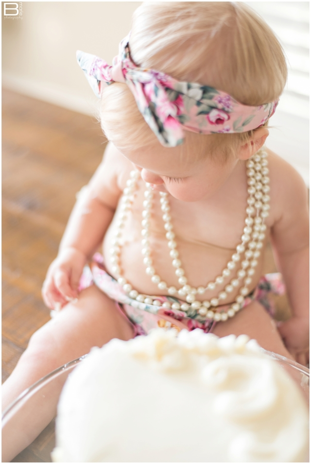 Houston cake smash photographer with floral outfits and pearls