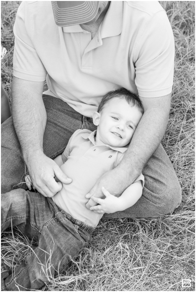 Kingwood family photographer maternity and family session in open field with 2 year old boy